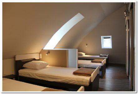 Chambre de 4 personnes avec deux salles d'eau